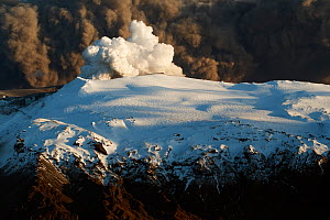 Subglacial volcanic eruption under the Eyjafjallajokull ice cap with ash plume from the volcano above, Iceland, April 2010  -  Erlend Haarberg