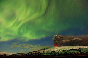 Subglacial volcanic eruption under the Eyjafjallajokull ice cap with northern lights above the ash plume at night, Iceland, April 2010 - Erlend Haarberg