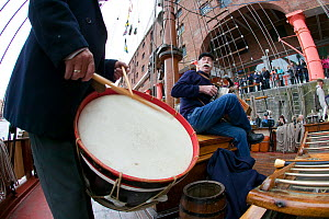 Musicians entertaining crowd during tall ships event at Liverpool River Festival. Albert Dock, River Mersey, England, September 2011. All non-editorial uses must be cleared individually. - David Woodfall
