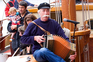 Accordian player at tall ships event during Liverpool River Festival. Albert Dock, River Mersey, England, September 2011. All non-editorial uses must be cleared individually.  -  David Woodfall