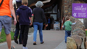 Visitors walking towards the entrance to the Scottish Seabird visitor Centre, North Berwick, East Lothian, Scotland, August 2011  -  Peter  Cairns / 2020VISION