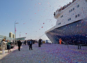 Confetti cannons firing as the 'Ocean Countess' prepares to depart as the first cruise ship to start and finish a cruise from the Liverpool waterfront for 40 years. Liverpool Cruise Liner Terminal, Ri... - Graham Brazendale