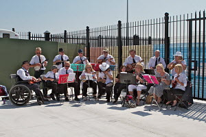 Ukulele band performance to send off the 'Ocean Countess', the first cruise ship to start and finish a cruise from the Liverpool waterfront for 40 years, River Mersey, England, May 2012. All non-edito... - Graham Brazendale