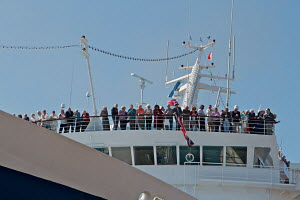 Passengers observing civil send-off from cruise liner 'Ocean Countess', the first cruise ship to start and finish a cruise from the Liverpool waterfront for 40 years. River Mersey, England, May 2012.... - Graham Brazendale