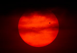 The transit of Venus across the face of the sun, with visible sunspots, as seen from Aurora, Colorado, USA, 19.49 local time, 5 June 2012.  -  Charlie Summers
