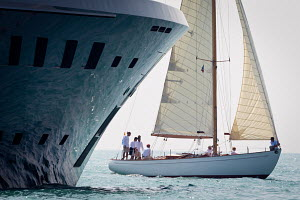 'Cerida' passing larger boat during the Panerai Classic Yacht Challenge: Voiles D'Antibes, France, May 2012. All non-editorial uses must be cleared individually.  -  Sea & See