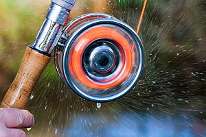 Water spray from a spinning fishing reel, River Tweed, Berwickshire, Scotland, UK, January 2012. 2020VISION Exhibition. 2020VISION Book Plate. Did you know? The earliest record of use of fishing reels...  -  Shaun Robertson / 2020VISION
