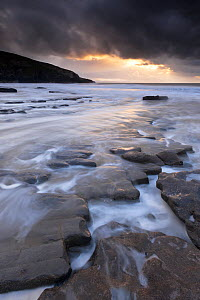 View of Southerndown with dark storm clouds overhead, Glamorgan Heritage Coast, near Bridgend, Wales, UK, December 2012.  -  Ross Hoddinott