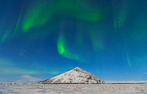 Northern lights / Aurora borealis over snowy landscape, Iceland, Europe, March 2012 - Juan Carlos Munoz