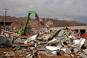 Fridges and various other metals in a large pile with machinery at Recycling Center, Ithaca, New York, USA, property released.  -  John Cancalosi