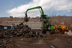 Machinery lifting tyres, Recycling Center, Ithaca, New York, USA, property released.  -  John Cancalosi
