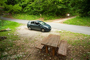 Car parked in woodland, used by photographer for meet your neighbour project, Savoie, France, June 2011. meetyourneighbours.net project  -  MYN / Denis Palanque