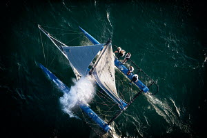 Aerial view of crew hiking-out on board Decision 35 'Realstone Sailing' during the Bol d'or Mirabaud as part of the Vulcain Trophy. Lake Geneva, Switzerland, June 2012. All non-editorial uses must be... - Chris Schmid