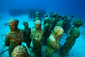 Submarine statues at the MUSA Cancun Underwater Museum, a conservation project to promote the growth of coral. Isla Mujeres, Cancun National Park, Caribbean Sea, Mexico. - Claudio Contreras