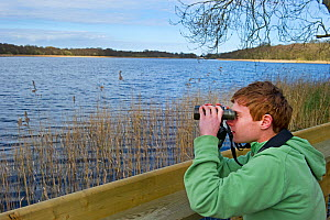 Boy birdwatching at Ormesby Little Broad, Trinity Broads, Norfolk Broads, Norfolk, UK, April 2012  -  David Tipling / 2020VISION