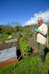 Man cultivating community allotments, part of local authority production of sustainable food, Agenda 21, April 2009. No release available. - David Woodfall