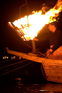 'Ukai', a traditional (1300 year old) night fishing method in which an 'usho' Cormorant Fishing Master and 'u' Great cormorant (Phalacrocorax carbo hannedae) work together to fish by the flames of 'Ka... - Ben Lascelles