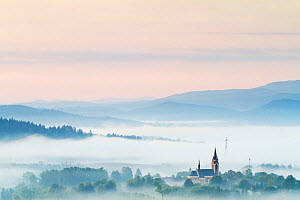 Fog rising from the meadows at dawn near Lutowiska, Bieszczady National Park, Poland, September 2011  -  Wild Wonders of Europe / Möllers