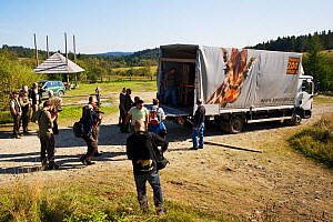 Staff of Bieszczady National Park and Prague Zoo watching the unloading of two crates containing two European bison / Wisent (Bison bonasus) donated by Prague Zoo to Bieszczady National Park, Bukowiec...  -  Wild Wonders of Europe / Möllers