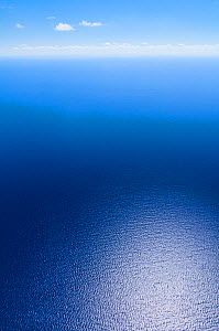 Aerial image showing light reflected off the deep blue of the sea around the Bahamas archipelago, Caribbean, February 2012  -  Juan Carlos Munoz