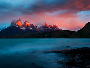 The blue green waters of Lago Pehoe, with the sunset light on Los Cuernos del Paine, in Torres del Paine National Park, Chile - Jack Dykinga