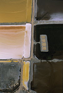 Aerial view of old basins used for concentrating magnesium sulphate (MgSO4) in the salt pans at Salin de Giraud, Camargue, Southern France  -  Jean E. Roche