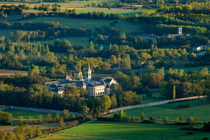 Aerial view of the Convent Ste Scolastique and the Abbaye St-Benoit near Dourgne at the foot of the Montagne Noire, in the rolling Lauragais countryside, Tarn, Midi-Pyrenees, France. September 2011.  -  David Noton