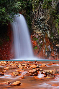 Red rocks coloured by the geothermal waters at Pulangbato Falls on Negros, The Visayas, Philippines  -  David Noton