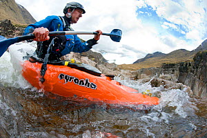 Kayaker on the River Etive, Highlands, Scotland, UK, April 2012. Did you know? Freshwater ecosystems have a higher density of species than either the land or the sea.  -  Alex Mustard / 2020VISION