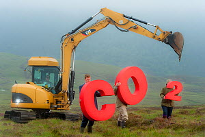 People holding signs spelling CO2, representing carbon capture for peatland burial, next todigging equipment. Sutherland, Scotland, July 2012.  -  Niall Benvie / 2020VISION