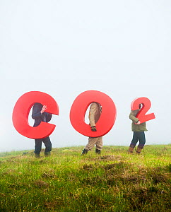 People holding signs spelling CO2, representing carbon capture for peatland burial. Sutherland, Scotland, July 2012.  -  Niall Benvie / 2020VISION