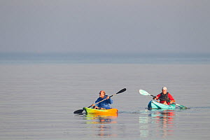 Two people Kayaking at dawn. The Wash Estuary, Norfolk, September. - Peter Cairns / 2020VISION