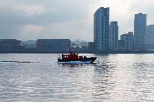 Pilot boat 'Dunlin' early morning on the River Mersey, Liverpool, England, May 2012. - Graham Brazendale