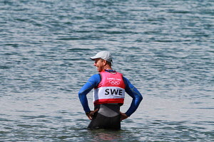 Freddie Loof (SWE) cooling off in the water after having won the Star class gold medal during the London 2012 Olympic Games, in Weymouth, Dorset, England, July 2012. For editorial use only. - Ingrid Abery