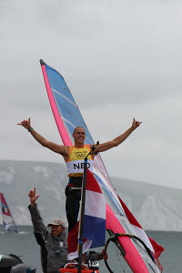 Dorian van Rijsselberge (NED) celebrating his gold medal success in the RS:X during the London 2012 Olympic Games, in Weymouth, Dorset, England, July 2012. For editorial use only. - Ingrid Abery