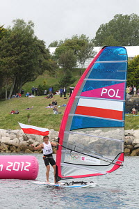 Przemyslaw Miarczynski (POL) winning the bronze medal in the RS:X during the London 2012 Olympic Games, in Weymouth, Dorset, England, July 2012. For editorial use only. - Ingrid Abery
