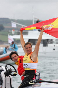 Marina Alabau Neira (ESP) celebrating gold medal success in the Women's RS:X during the London 2012 Olympic Games, in Weymouth, Dorset, England, July 2012. For editorial use only. - Ingrid Abery