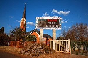 South African church with save the rhino anti-poaching slogan on electronic advertising billboard, Klerksdorp, North west province, South Africa, June 2012. Editorial use only  -  Ann & Steve Toon