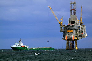 Supply vessel offloading containers at the 'Oseberg Ost' platform, North Sea, Europe, May 2012.  -  Philip Stephen