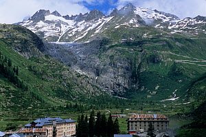 Rhone Glacier scarring in 2004, with buildings in foreground. Compare with image 1403312 showing signs of glacial retreat.  -  Jean E. Roche
