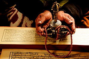 Buddhist Monk hands with prayer scripture and beads in Samdo village (3.690m). Manaslu Conservation Area, Himalayas, Nepal, October 2009.  -  Enrique Lopez-Tapia