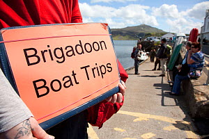 Tourist signs promoting boat trips based around the presence of White tailed sea eagles, Portree, Skye, Inner Hebrides, Scotland, UK, June 2011. 2020VISION Book Plate.  -  Peter Cairns / 2020VISION