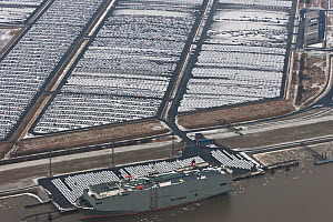 Aerial view of Emden Port, with boat at harbour and new cars for shipping overseas, East Frisia, Lower Saxony, Germany February 2012  -  Kerstin Hinze