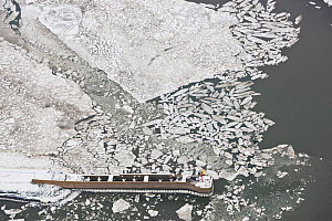 Aerial view of frozen harbour of Langeoog in winter with ice sheets and snow, East Frisia, North Sea, Lower Saxony, Germany February 2012  -  Kerstin Hinze