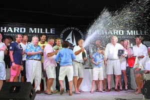 Rambler 100 team celebrate winning overall regatta trophy following Les Voiles de St Barth, St Barthelemy, Caribbean, April 2012. All non-editorial uses must be cleared individually.  -  Ingrid Abery