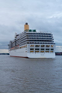 Cruise liner 'Arcadia' arriving at the Liverpool Cruise Liner Terminal in early morning, River Mersey, June 2012. For editorial use only. - Graham Brazendale