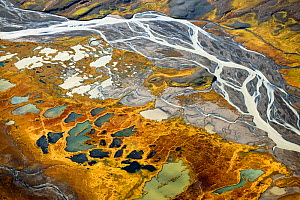 Aerial view down river to the east of the Hofsjakull glacier and west of the Sprengisandur upland desert. Innumerable rivulets flow from beneath the glacier in this area of tundra which abounds in pon...  -  Erlend Haarberg,Erlend  Haarberg