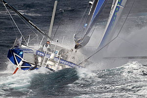 IMOCA 60 'Banque Populaire' skippered by Armel le Cleac'h in heavy seas ahead of the Vendee Globe, Lorient, France, September 2012. All non-editiorial uses must be cleared individually.  -  Benoit Stichelbaut