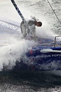 Skipper Armel le Cleac'h at work on the bow of IMOCA 60 'Banque Populaire' in heavy seas ahead of the Vendee Globe, Lorient, France, September 2012. All non-editiorial uses must be cleared individuall...  -  Benoit Stichelbaut