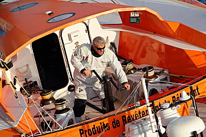 Skipper Vincent Riou grinding on board IMOCA 60 'PRB' ahead of the Vendee Globe, Ile des Gl�nans, France, September 2012. All non-editiorial uses must be cleared individually. - Benoit Stichelbaut